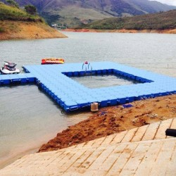 Boat and swimming pontoon